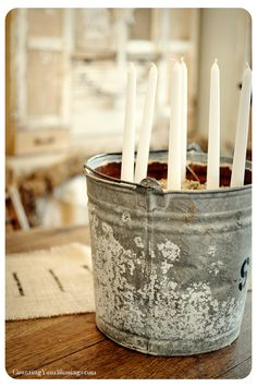 Candles in a galvenized bucket for a centerpiece (from Counting Your Blessings)
