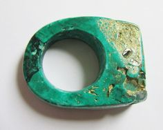 Ring of resin with gold luster finish and pyrite inclusions.  Designer: Jade Mellor (UK).