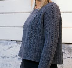 The classic fisherman sweater gets a modern makeover in Clio, where a blend of rich textured panels, slip-stitch ribbing and crisp cables are at once contemporary and timeless. Clio is worked from the top down, with a wide ribbed neckline and unique shoulder construction that combines a saddle shoulder and drop shoulder for a comfortable fit. Instructions are given for two versions: cropped with a boxy shape, or hip-length and fitted, with an optional split hem.