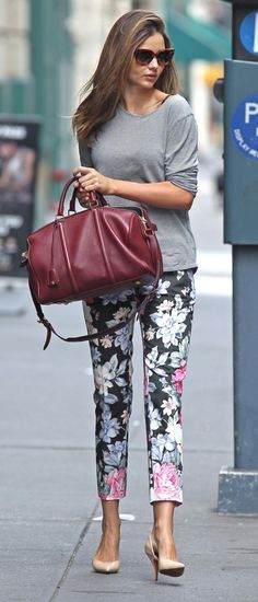 Miranda Kerr street style, floral pattern pants, gray shirt, heels and oversized  burgundy bag - celebrity fashion