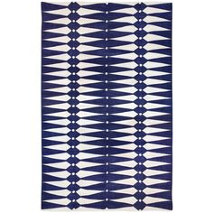 Jonathan Adler's lightweight Dorothy rug surprises with a crisp pattern and rich texture. In navy blue and natural white, the contemporary floor covering's geo…