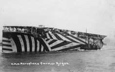 The British Aircraft Carrier HMS Argus. Converted from an ocean liner, the Argus could carry 15-18 aircraft. Commissioned at the very end of WWI, the Argus did not see any combat. The ship's hull is painted in Dazzle camouflage. Dazzle camouflage was...