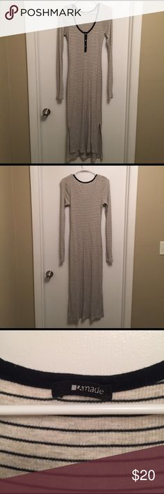 Long sleeved striped maxi dress Long sleeved cotton maxi dress with a small button down front and slits up both sides. Very flattering and comfortable. Only worn a few times. LA Made Dresses Maxi