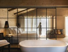 Bedroom with glass wall #bed #bedroom #bath #tub #glass #wall #wooden #chalet #cottage