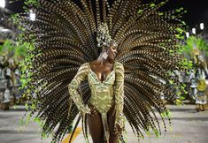 A reveler of Imperatriz Leopoldinense samba school performs during the second night of Carnival parades at the Sambadrome in Rio de Janeiro on February (Christophe Simon/Getty Images) Carnaval In Rio, Carnaval Costume, Trinidad Carnival, Rio Carnival, Carnival Girl, Carnival Dancers, Carnival Tickets, Fotojournalismus, Carnival Outfits