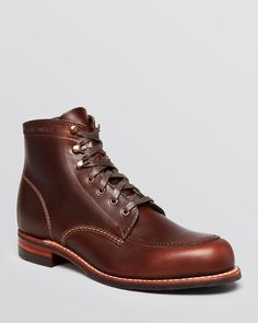 Handcrafted in the Usa with a Horween leather upper and Goodyear welt construction, these rugged lace-up boots are built to last.   Leather/rubber   Made in USA   Leather upper, leather and vibram sol
