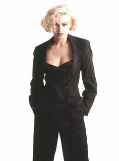...  you can see some recurring hairstyles through the time line such as her favorite medium blonde curls.