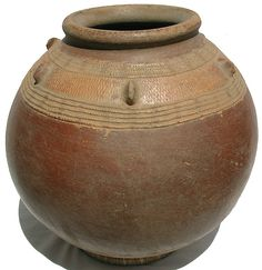 Africa    large antique terra cotta pot from the Dogon people of Mali. It is the earthen color of red terra cotta with two rows of cream colored textured designs circling the pot just below the rim    not sure how old this piece is