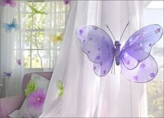 butterflies and flowers in liv's room.  and purple, pink, green, blue, and yellow looks great.