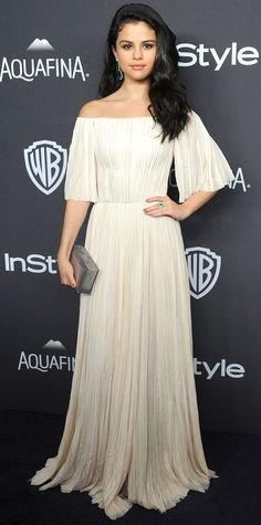 Selena Gomez looked like an angel at the InStyle Golden Globes Post-Party in a blush off-shoulder pleated J. Mendel gown, accessorizing with Jacob & Co. jewelry and a box Rauwolf clutch.