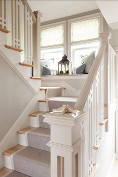 Lovely stairway, white risers and handrail,, neutral carpet runner
