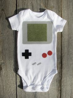 this cracks me up - a newborn is almost the same size as the actual gameboy was, lol