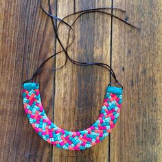 FUN, FUNKY, CASUAL, VERSATILE and SUSTAINABLE  Created from the fabric of recycled t-shirts, this necklace is comfortable, light as a feather and even machine washable! Add some colour to your favourite black dress without looking too fancy, or spice up jeans and a t-shirt!Made in Melbourne - OOAK