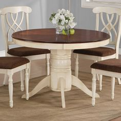 Pedestal Dining Table In Buttermilk With A Dark Cherry Finished Surface.  Product: Dining
