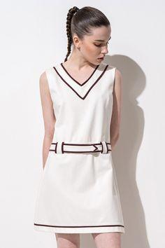 "<p>""V"" neck design. ""A""Shape design. About me:. 67% viscose 26% nylon 7% spandex. Lining:. 100% polyester</p>"