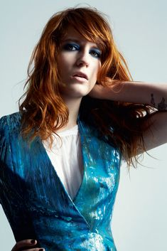 the contrast between the red hair and the teal blue dress and makeup.