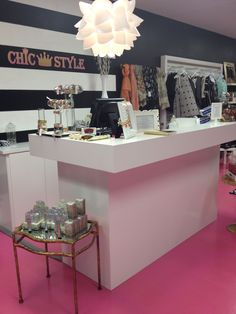 www.chicstyleutah.com a clothing boutique in Bountiful Utah , one of three stores! Design , Hollywood regency .. Counter design black and white stripes! Hot pink look chic at affordable prices!