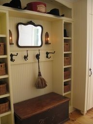 Entryway idea. Love the side shelves with baskets. Mirror above bench and long shelf on top