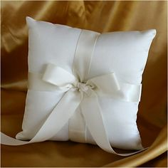 "WeddingDepot.com ~ Ring Bearer Pillow - Tied With a Bow - Ivory ~ This ring pillow of ivory matte satin is just the touch of charm your wedding day needs. A creamy bow ties this look together from all four sides. Measures 7"" X 7""."