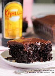 Moist from scratch chocolate cake with a Kahlua spiked pudding and a quick 1 minute frosting! This is my husband's new favorite cake!