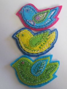 Embroidered felt bird brooches - made by Kate Clark