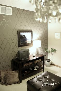 Wall stenciled with shimmery paint - IN LOVE for the entryway!