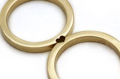Matching Wedding Rings That Become One When Combined