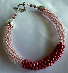 Metallic red and crystal beaded Kumihimo bracelet with silver plate accents by TheBeckoningCat on Etsy