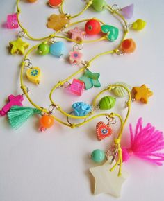 silly old suitcase beads on jumprings tied with a knot