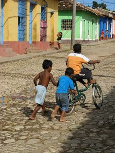 CUBAN CHILDREN PLAYING IN THE STREETS