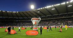 Inflatable Cup. Brand activation event in football stadium.