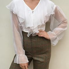 Vintage sheer ruffled cropped blouse. S/m , a couple places of hardly noticeable markings. Rare favorite find $68 + shipping SOLD