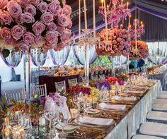 An extremely chic table setting plays against the beautiful striped ceiling.