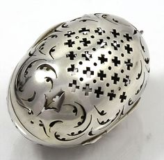 English hallmarked silver pierced tea ball from London, 1855.