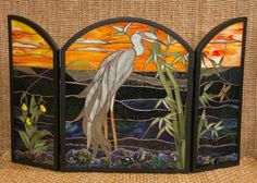 I really want a stained glass fire screen for my hearth. This picture does not do justice to this work of art. The artist did one with her rendition of Van Gogh's 'Starry Night' that is breath taking.