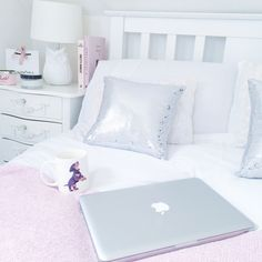 Pink throw with a hint of sparkle with sequin scatter cushions.