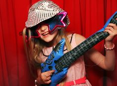 Check out this girl rocking it in our new photo booth - Rock n Roll