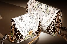 The new #RobertoCavalli Hera bag in animal pattern is one of this season's top accessories!
