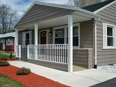 small-ranch-style-house-with-front-porch-designs- this without the ramp but a step on the end