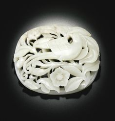 A reticulated celadon jade 'Bird and Flower' plaque, Jin-Yuan dynasty
