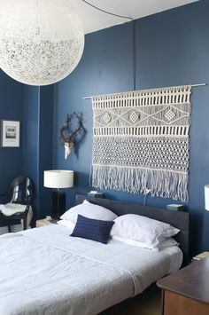 I love the almost cornflower blue walls and brown and white accessories in this room. i think it's too dark for our bedroom though. From Apartment Therapy.