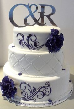 Purple & Silver Theme / purple white silver 3 tier wedding cake with floral detail. Maybe for the top cake tier, simple white with a purple flourish like that?