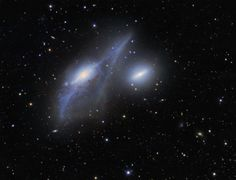 Across the heart of the Virgo Galaxy Cluster lies a string of galaxies known as Markarian's Chain. Prominent in Markarian's Chain are these two interacting galaxies, NGC 4438 (left) and NGC 4435 - also known as The Eyes.