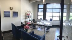 My office--navy and white theme, nailhead chairs, pink accents, white desk, white campaign style credenza, gold shelf