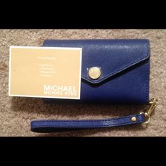 "SUNDAY SALE!!! NWT Michael Kors Wallet SUNDAY SALE NWT- Michael Kors Wallet/ iPhone Holder for iPhones 3G, 3GS, & 4.  Also holds credit cards, Id's, and change.  Midnight Blue & super cute!!! Measures approx 5"" in length & 3"" in height.  When the wallet is open it's about 7"" long.  The tag isn't attached to the wallet but is in the back pocket. Michael Kors Bags Wallets"