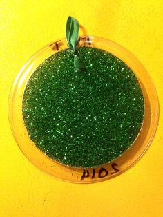 Back side of glitter plate ornament. Remember to spray glitter side with hairspray to keep glitter set in place.