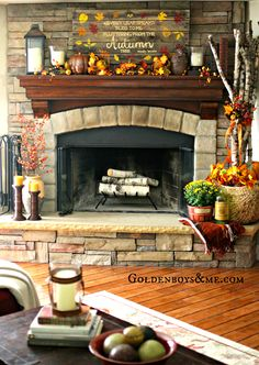 Hand painted and stenciled pallet sign on corner stone fireplace with birch logs, part of Fall Home Tour via www.goldenboysandme.com