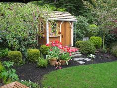 Love this little playhouse/shed especially the arched door.   A Glimpse into my Shed's Future | Beneath My Heart