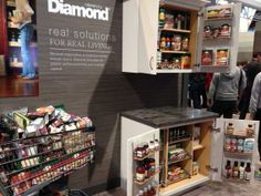 Can you believe all the groceries in this stuffed shopping cart fit neatly in these two cabinets from Diamond Cabinetry! Photo is from the Kitchen & Bath Show, KBIS, going on Feb. 4 - 6 in Las Vegas. #KBIS2014