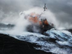 An image taken in Mousehole, Cornwall, from Courage on Our Coasts, an exhibition of photographs by lifeboat crew member Nigel Millard which will be at the Old Coastguard Hotel until 4 March when the RNLI marks its 140th anniversary.